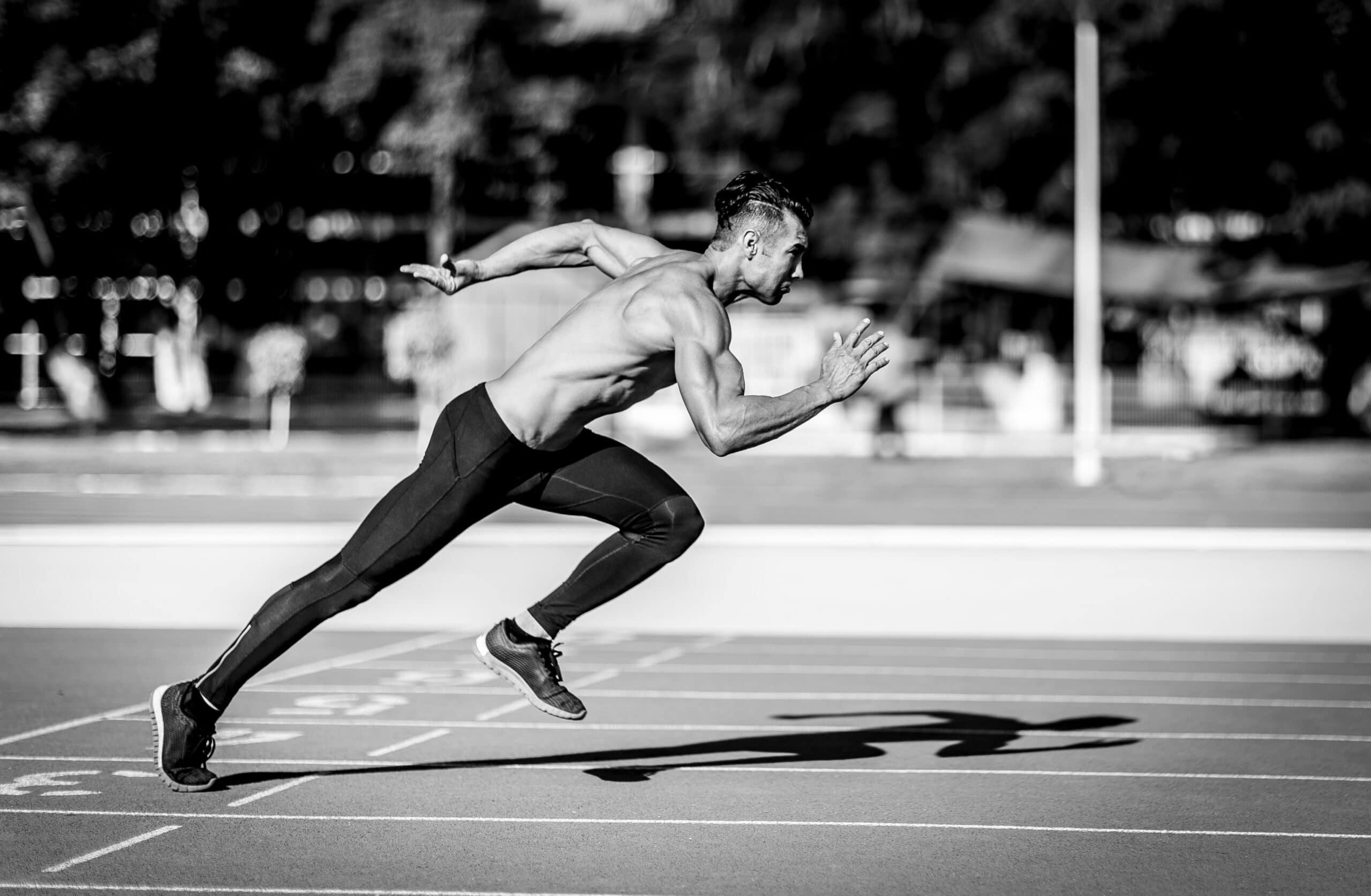 muscular-man-running-on-track