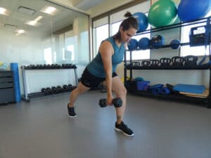 woman-doing-frontal-lunge-with-a-dumbbell